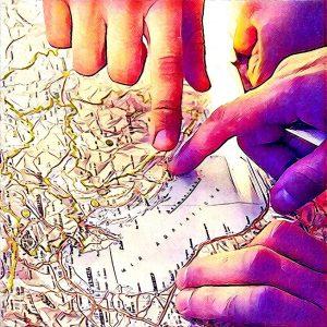 Dedos señalando ruta en el mapa